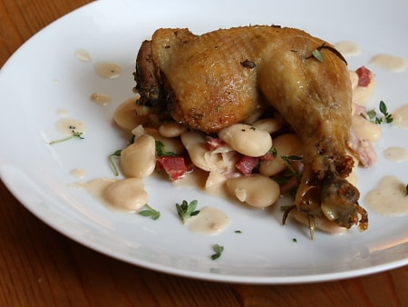 Confit chicken legs with butter beans and chorizo stew