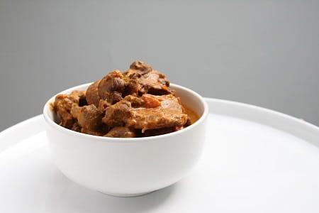 badhami roghan rogan josh – lamb in a dark almond sauce