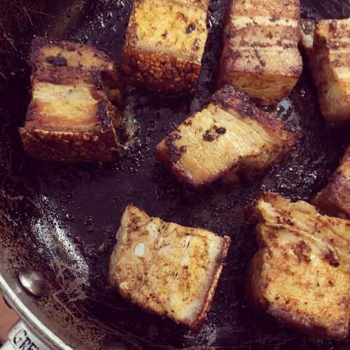 Pork belly braised in beer, with Cajun spices